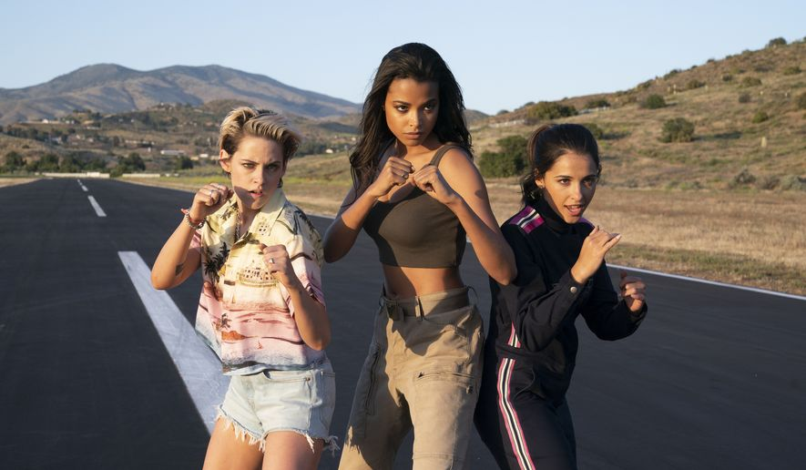"""This image released by Sony Pictures shows, from left, Kristen Stewart, Ella Balinska and Naomi Scott in """"Charlie's Angels,"""" in theaters on Nov. 15. (Merie Weismiller Wallace/Sony Pictures via AP)"""