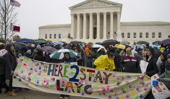 Immigration activists rallied outside the Supreme Court just days before U.S. Citizenship and Immigration Services released a report showing that dozens were granted protection under the Deferred Action for Childhood Arrivals program despite having serious criminal records. (Associated Press)