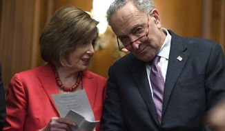 House Speaker Nancy Pelosi of Calif., left, and Senate Minority Leader Sen. Chuck Schumer of N.Y., right, talk as they wait to speak at an event on Capitol Hill in Washington, Tuesday, Nov. 12, 2019.  (AP Photo/Susan Walsh)