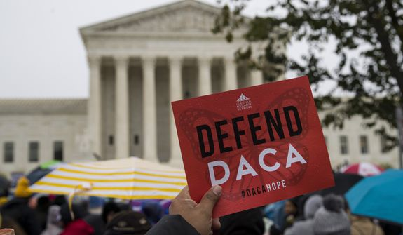 People rally outside the Supreme Court as oral arguments are heard in the case of President Trump's decision to end the Obama-era, Deferred Action for Childhood Arrivals program (DACA), Tuesday, Nov. 12, 2019, at the Supreme Court in Washington. (AP Photo/Alex Brandon)