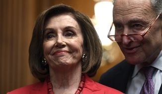House Speaker Nancy Pelosi of Calif., left, and Senate Minority Leader Sen. Chuck Schumer of N.Y., right, listen as they wait to speak at an event on Capitol Hill in Washington, Tuesday, Nov. 12, 2019. (AP Photo/Susan Walsh)  ** FILE **