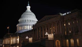 Floodlights illuminate the U.S. Capitol dome in Washington, late Tuesday, Nov. 12, 2019. (AP Photo/Patrick Semansky) **FILE**