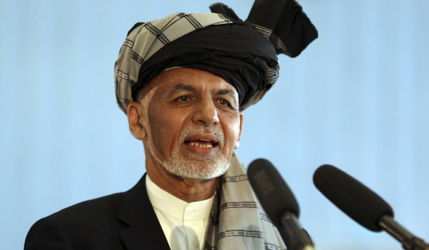 In this Sept. 28, 2019, file photo, Afghan President Ashraf Ghani speaks to journalists after voting at Amani high school, near the presidential palace in Kabul, Afghanistan. President Ghani said Tuesday, Nov. 12, his government has released three Taliban figures in an effort to have the insurgents free an American and an Australian professor they abducted in 2017. (AP Photo/Rahmat Gul, File)