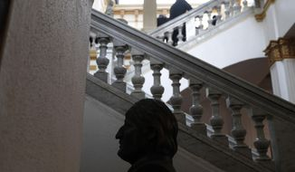 A bust of Bolivia's former President Evo Morales stands in Congress in La Paz, Bolivia, Tuesday, Nov. 12, 2019. Morales, who transformed Bolivia as its first indigenous president, was flying to exile in Mexico on Tuesday after weeks of violent protests, leaving behind a confused power vacuum in the Andean nation. (AP Photo/Juan Karita)