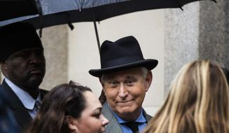 Roger Stone, a longtime Republican provocateur and former confidant of President Donald Trump, waits in line at the federal court in Washington, Tuesday, Nov. 12, 2019. (AP Photo/Manuel Balce Ceneta)