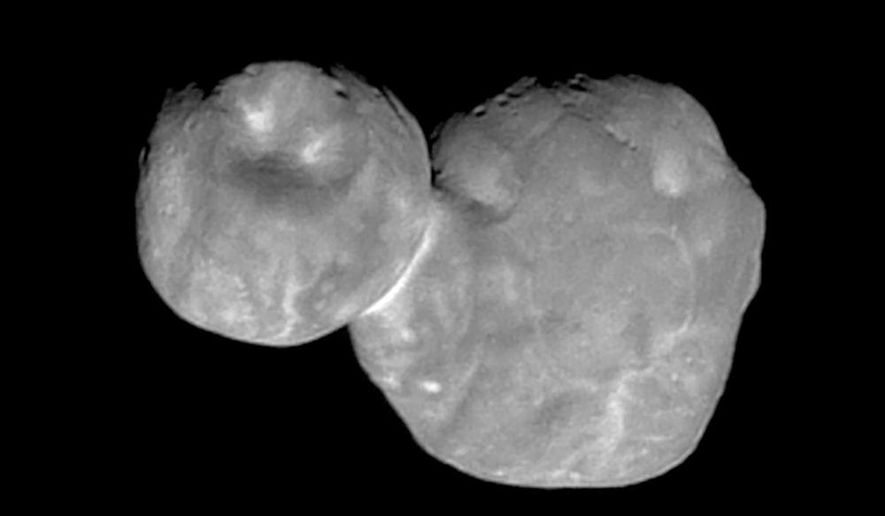 """FILE - This Tuesday, Jan. 1, 2019 image made available by NASA shows the Kuiper belt object originally called """"Ultima Thule,"""" about 1 billion miles beyond Pluto, encountered by the New Horizons spacecraft. On Tuesday, Nov. 12, 2019, NASA announced its official name """"Arrokoth"""" which means """"sky"""" in the language of the Native American Powhatan people.(NASA/Johns Hopkins University Applied Physics Laboratory/Southwest Research Institute via AP, File)"""