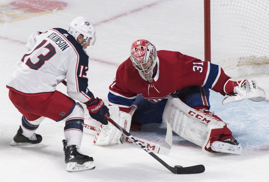 Montreal Canadiens goaltender Carey Price makes a save against Columbus Blue Jackets' Cam Atkinson during the shootout in an NHL hockey game Tuesday, Nov. 12, 2019, in Montreal. (Graham Hughes/The Canadian Press via AP)