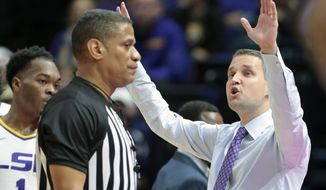 LSU head coach Will Wade, right, reacts after a play during first-half action against Bowling Green during an NCAA college basketball game in Baton Rouge, La. Friday, Nov. 8, 2019. (AP Photo/Brett Duke)