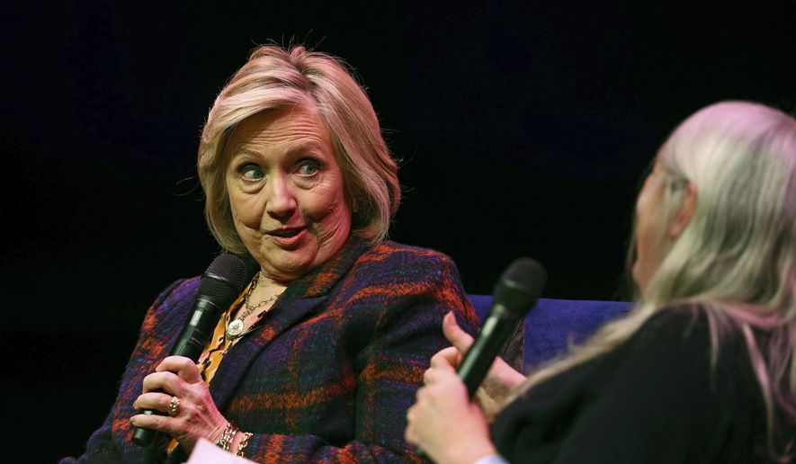 "U.S. former Secretary of State Hillary Clinton, left, talks to Classicist Mary Beard, at the Southbank Centre in London during the launch of ""Gutsy Women: Favorite Stories of Courage and Resilience,"" a book by Chelsea and Hillary Clinton, in London, Sunday, Nov. 10, 2019. (Aaron Chown/PA via AP) ** FILE **"