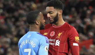 Liverpool's Joe Gomez, right, and Manchester City's Raheem Sterling clash during the Premier League soccer  match at Anfield, Liverpool, Sunday Nov. 10, 2019. Raheem Sterling will not be considered for England's European Championship qualifier against Montenegro after emotions ran high when the team gathered on Monday following Manchester City's loss to Liverpool. A day after the Premier League top-of-the-table match at Anfield, where Sterling clashed with Liverpool defender Joe Gomez near the end, both players apparently became involved in another exchange when the England squad convened at the national training center at Burton upon Trent. (Peter Byrne/PA via AP)