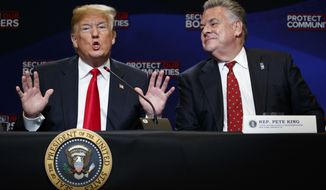 "FILE - In this May 23, 2018, file photo, Rep. Peter King, R-N.Y., right, listens as President Donald Trump speaks during a roundtable on immigration policy at Morrelly Homeland Security Center in Bethpage, N.Y. King announced Monday, Nov. 11, 2019,  he will not seek reelection in 2020. The 14-term Republican congressman said in a Facebook post that his commute was a main factor in his decision, saying he wants ""flexibility to spend more time"" with his children and grandchildren. (AP Photo/Evan Vucci, File)"
