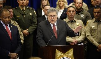 U.S. Attorney General William Barr, center, with other federal and officials, announces that nearly 330 fugitives suspected of violent crimes have been arrested as part of a crime-fighting initiative in New Mexico, at a news conference at the office of the Bernalillo County Sheriff in Albuquerque, N.M., Tuesday, Nov. 12, 2019. Barr was in Albuquerque to highlight the results of Operation Triple Beam, a program that has been conducted in numerous U.S. cities and has led to hundreds of arrests. (Adolphe Pierre-Louis/The Albuquerque Journal via AP) **FILE**