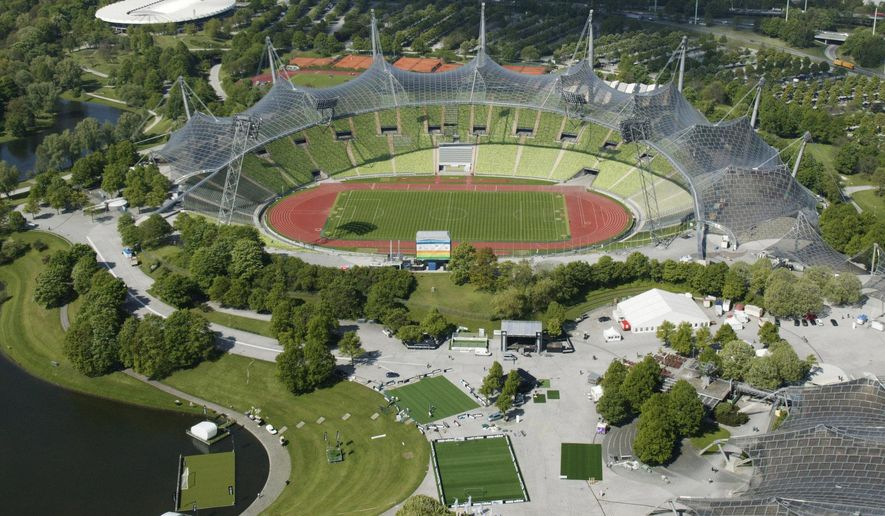 This June 2005 file photo, shows the view from the the Olympic Tower on the Olympic Park with the Olympic Stadium in Munich, Germany. Munich has been awarded the 2022 edition of the multi-sport European Championships. (AP Photo/Uwe Lein)