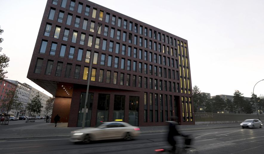 Cars drive past the center for advanced education (ZNAF) at the Federal Intelligence Service (BND) in Berlin, Germany, Tuesday, Nov. 12, 2019. Germany's intelligence agencies are inaugurating a joint spy school in the heart of Berlin, a city that was dubbed the 'capital of spies' during the Cold War and remains a hotspot of espionage.(AP Photo/Michael Sohn)