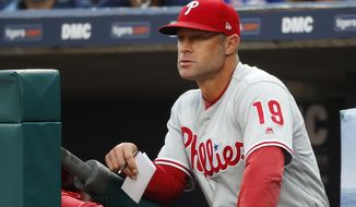 FILE - In this July 23, 2019, file photo, Philadelphia Phillies manager Gabe Kapler watches the team play the Detroit Tigers in the first inning of a baseball game in Detroit. Kapler is new manager of the San Francisco Giants, replacing Bruce Bochy, who retired when the season ended. The Giants made the announcement late Tuesday, Nov. 12, and planned a formal introduction to follow. The 44-year-old Kapler was fired Oct. 10 after two seasons in Philadelphia and a 161-163 record. (AP Photo/Paul Sancya, File)