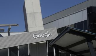 FILE - This Sept. 24, 2019, file photo shows a Google sign on the campus in Mountain View, Calif. Google is working with large health care system Ascension. The partnership is intended to use artificial intelligence to find patterns that could help doctors, but some are concerned about privacy and protecting patients' sensitive health information. (AP Photo/Jeff Chiu, File)