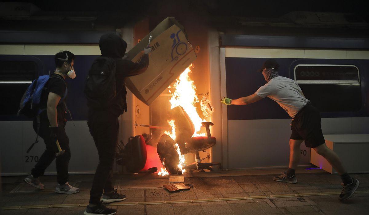 Chinese students flee Hong Kong as violence intensifies