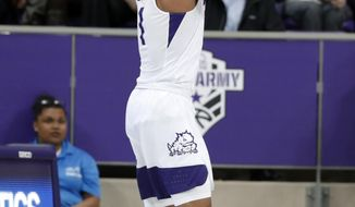 TCU guard Desmond Bane attempts a 3-point basket during the first half of the team's NCAA college basketball game against Louisiana-Lafayette in Fort Worth, Texas, Tuesday, Nov. 12, 2019. (AP Photo/Tony Gutierrez)