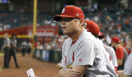 In this Sept. 25, 2019, file photo, St. Louis Cardinals manager Mike Shildt pauses in the dugout during the fifth inning of the team's baseball game against the Arizona Diamondbacks in Phoenix. Shildt has edged out Craig Counsell of the Milwaukee Brewers to win NL Manager of the Year. (AP Photo/Ross D. Franklin, File) **FILE**