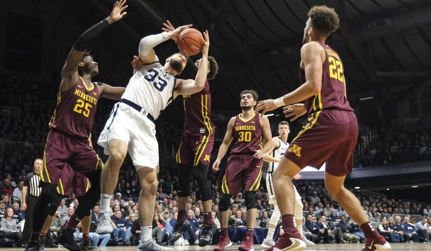 Butler forward Bryce Golden (33) pulls down a rebound in front of Minnesota center Daniel Oturu (25) in the first half of an NCAA college basketball game in Indianapolis, Tuesday, Nov. 12, 2019. Butler won 64-56. (AP Photo/AJ Mast)