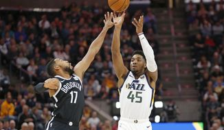 Utah Jazz guard Donovan Mitchell (45) shoots as Brooklyn Nets guard Garrett Temple (17) defends in the first half during an NBA basketball game Tuesday, Nov. 12, 2019, in Salt Lake City. (AP Photo/Rick Bowmer)