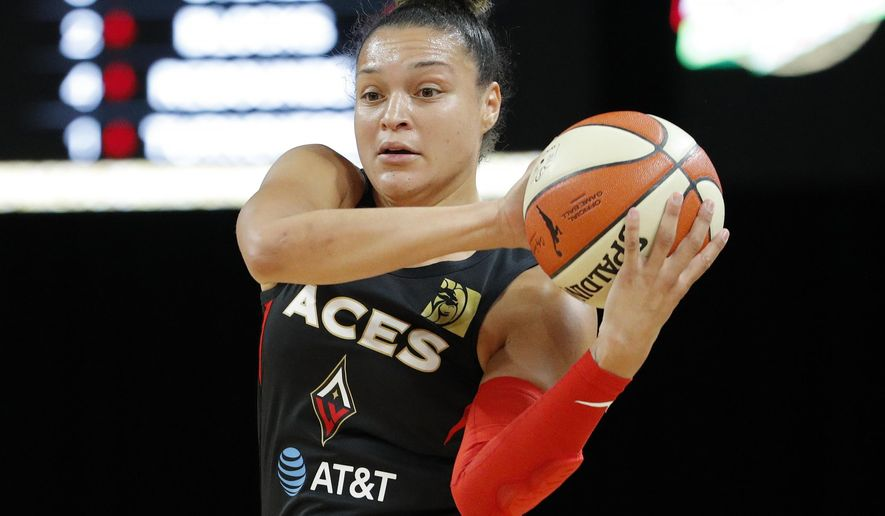 FILE - In this Sept. 22, 2019, file photo, Las Vegas Aces' Kayla McBride passes around the Washington Mystics during the first half in Game 3 in the semifinals of the WNBA playoffs in Las Vegas. Former Notre Dame great McBride is back on campus this winter as a player development program manager. (AP Photo/John Locher, File)