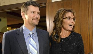 In this Nov. 7, 2013 file photo, former Alaska Gov. Sarah Palin and her husband Todd arrive at the Grove Park Inn for a celebration of evangelist Billy Graham's 95th birthday in Asheville, N.C.  Sarah Palin says she found out her husband was seeking a divorce from his attorney. The revelation came in an interview released Tuesday, Nov. 12, 2019, with James Dobson, founder of the Family Talk Christian ministry.  (AP Photo/The Charlotte Observer, Todd Sumlin, File)