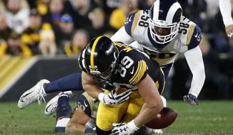 Pittsburgh Steelers tight end Vance McDonald (89) fumbles the football as he is tackled by Los Angeles Rams inside linebacker Cory Littleton (58) during the second half of an NFL football game in Pittsburgh, Sunday, Nov. 10, 2019. Littleton recovered the fumble for the Rams. (AP Photo/Don Wright)