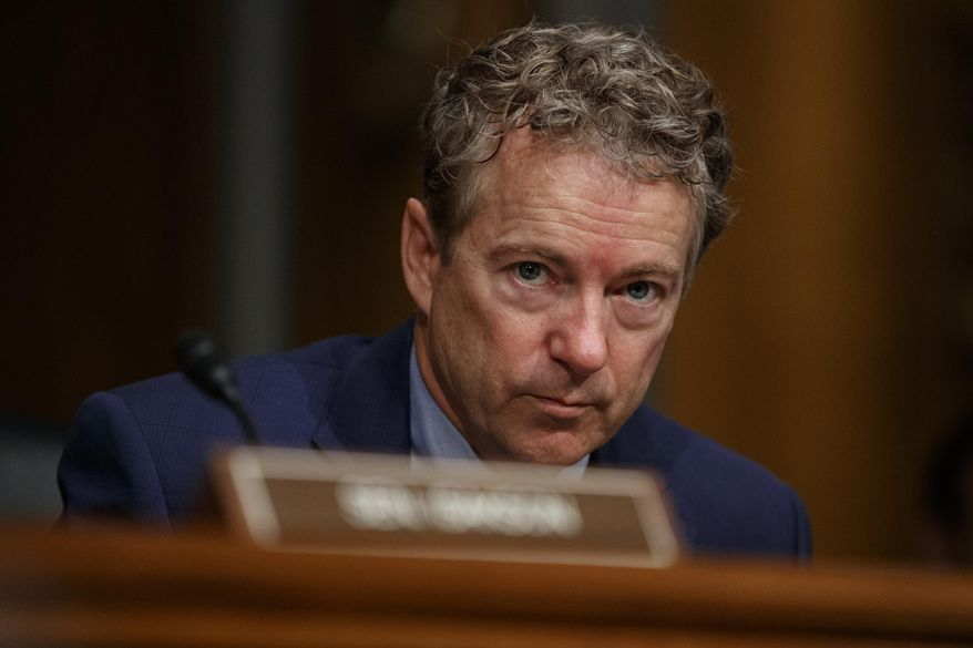 """This March 5, 2019, file photo shows Sen. Rand Paul, R-Ky., pausing during a Senate Committee on Health, Education, Labor, and Pensions hearing on Capitol Hill in Washington.  Rene Boucher who tackled Paul and broke his ribs has asked for the Supreme Court's opinion after an appellate court vacated his 30-day jail sentence and suggested it was too lenient. A three-judge panel of the 6th U.S. Circuit Court of Appeals ruled in September 2019 that there was """"no compelling justification"""" for Rene Boucher's sentence. The judges called the sentence """"well-below-guidelines"""" and ordered a resentencing. (AP Photo/Carolyn Kaster, File)"""