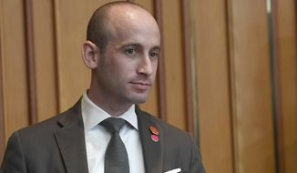 """FILE - In a Sunday, June 30, 2019 file photo, White House senior policy adviser Stephen Miller waits for the start of a meeting with President Donald Trump and South Korean President Moon Jae-in in Seoul. The Southern Poverty Law Center has published emails that it says show White House adviser Stephen Miller """"promoted white nationalist literature and racist propaganda"""" to a conservative news site. The nonprofit's Hatewatch blog published excerpts Tuesday, Nov. 12, 2019 of leaked emails Miller sent to Breitbart editors in 2015 and 2016.   (AP Photo/Susan Walsh, File)"""