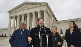 Attorney Cristobal Galindo, second from left, speaks accompanied by Jesus Hernandez, left, and Maria Guereca, and attorney Marion Reilly after oral arguments in front of the Supreme Court, Tuesday, Nov. 12, 2019 in Washington. The case involves U.S. border patrol agent Jesus Mesa, Jr., who fired at least two shots across the Mexican border, killing Sergio Adrian Hernandez Guereca, 15, who'd been playing in the concrete culvert between El Paso and Cuidad Juarez. (AP Photo/Alex Brandon)