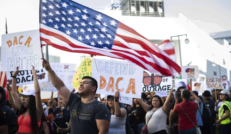 Ernesto Parada, 28, a graduate student at California State University, Northridge, marches Tuesday, Nov. 12, 2019, through downtown Los Angeles to MacArthur Park, to defend the Deferred Action for Childhood Arrivals program while the U.S. Supreme Court considers the fate of the Obama-era immigration program being challenged by the Trump administration. (Sarah Reingewirtz/The Orange County Register/SCNG via AP)