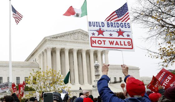 People rally outside the Supreme Court as oral arguments are heard in the case of President Trump's decision to end the Obama-era, Deferred Action for Childhood Arrivals program (DACA), Tuesday, Nov. 12, 2019, at the Supreme Court in Washington. (AP Photo/Jacquelyn Martin)