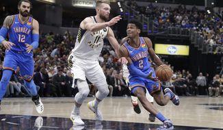 Oklahoma City Thunder guard Shai Gilgeous-Alexander (2) drives on Indiana Pacers forward Domantas Sabonis (11) during the first half of an NBA basketball game in Indianapolis, Tuesday, Nov. 12, 2019. (AP Photo/Michael Conroy)