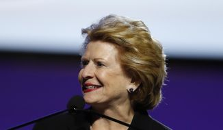 FILE - In this July 22, 2019 file photo, Sen. Debbie Stabenow, D-Mich., speaks in Detroit. Stabenow says President Donald Trump's $16 billion bailout package for farmers hurt by the trade war with China unfairly picks winners and losers, pitting the North against the South and small farms against wealthy producers. (AP Photo/Carlos Osorio,File)