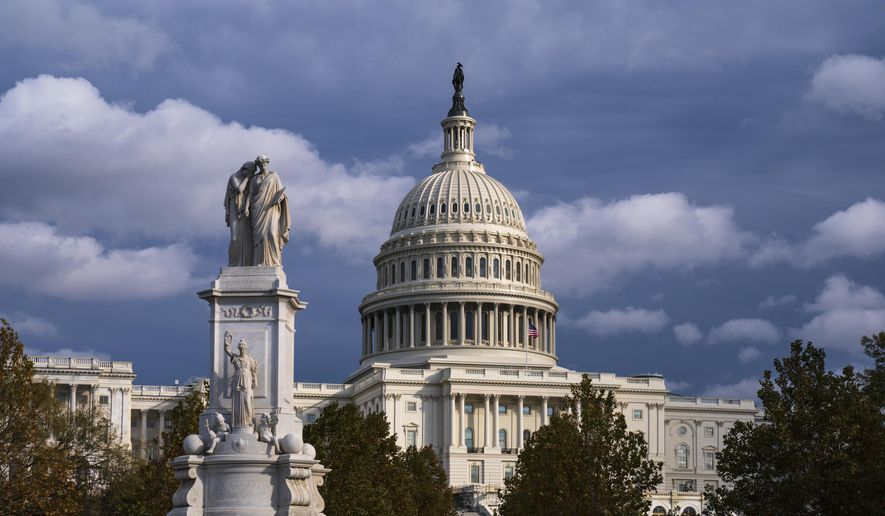 The U.S. Capitol is seen as the House is set to begin public impeachment inquiry hearings as lawmakers debate whether to remove President Donald Trump from office, in Washington, Tuesday, Nov. 12, 2019. At left is the Peace Monument. (AP Photo/J. Scott Applewhite)