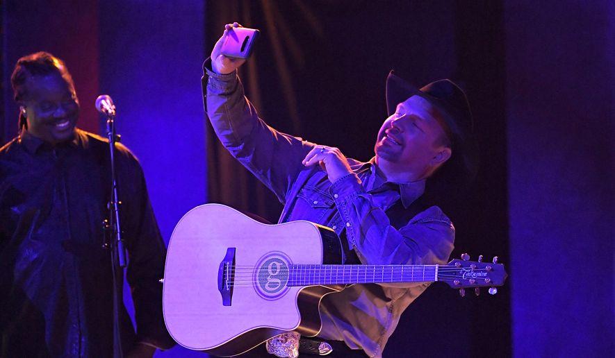 "Garth Brooks performs ""Dive Bar"" at the 53rd annual CMA Awards at Bridgestone Arena, Wednesday, Nov. 13, 2019, in Nashville, Tenn. (AP Photo/Mark J. Terrill)"