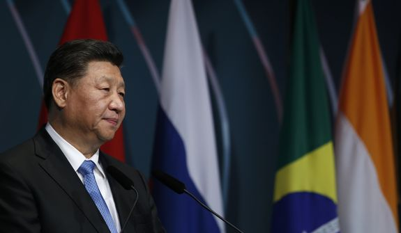 China's President Xi Jinping speaks during the BRICS Business Council prior the 11th edition of the BRICS Summit, in Brasilia, Brazil, Wednesday, Nov. 13, 2019. The BRICS Summit gathers the group of countries formed by Brazil, Russia, India, China and South Africa, which will take place in the 13th and 14th of this month. (AP Photo/Eraldo Peres)