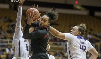 Maryland guard Blair Watson (22) pulls down a rebound between James Madison guard Kiki Jefferson (30), left, and forward Devon Merritt (42) during the first half of an NCAA college basketball game in Harrisonburg, Va., Wednesday, Nov. 13, 2019. (Daniel Lin/Daily News-Record via AP)