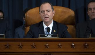 House Intelligence Committee Chairman Adam Schiff of Calif., speaks during the House Intelligence Committee on Capitol Hill in Washington, Wednesday, Nov. 13, 2019, in the first public impeachment hearing of President Donald Trump's efforts to tie U.S. aid for Ukraine to investigations of his political opponents.. (Saul Loeb/Pool Photo via AP)
