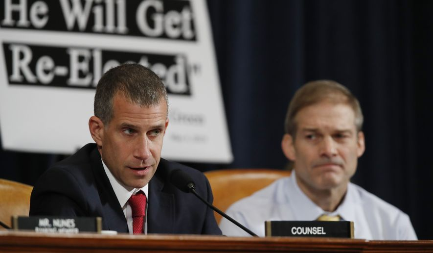 Republican staff attorney Steve Castor questions top U.S. diplomat in Ukraine William Taylor, and career Foreign Service officer George Kent, as Rep. Jim Jordan, R-Ohio looks on, at a House Intelligence Committee hearing on Capitol Hill in Washington, Wednesday, Nov. 13, 2019, during the first public impeachment hearing of President Donald Trump's efforts to tie U.S. aid for Ukraine to investigations of his political opponents. (AP Photo/Alex Brandon)