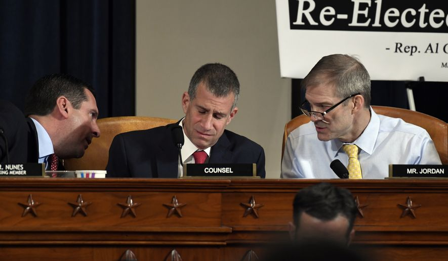 Ranking member Rep. Devin Nunes, R-Calif., talks to Rep. Jim Jordan, R-Ohio, right, as Steve Castor, Republican staff attorney for the House Oversight Committee, center listens during the House Intelligence Committee on Capitol Hill in Washington, Wednesday, Nov. 13, 2019, during the first public impeachment hearing of President Donald Trump's efforts to tie U.S. aid for Ukraine to investigations of his political opponents. (AP Photo/Susan Walsh)