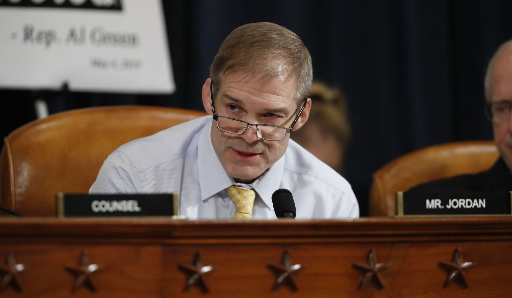 Whistleblower's identity looms large at House impeachment hearing