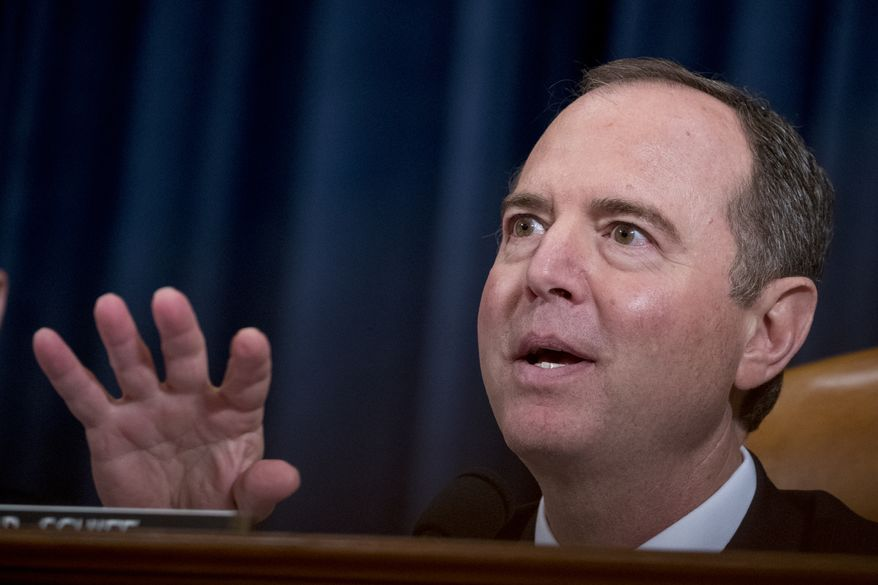 House Intelligence Committee Chairman Adam Schiff, D-Calif., speaks as career Foreign Service officer George Kent and top U.S. diplomat in Ukraine William Taylor appear before the House Intelligence Committee on Capitol Hill in Washington, Wednesday, Nov. 13, 2019, during the first public impeachment hearing of President Donald Trump's efforts to tie U.S. aid for Ukraine to investigations of his political opponents. (AP Photo/Andrew Harnik)