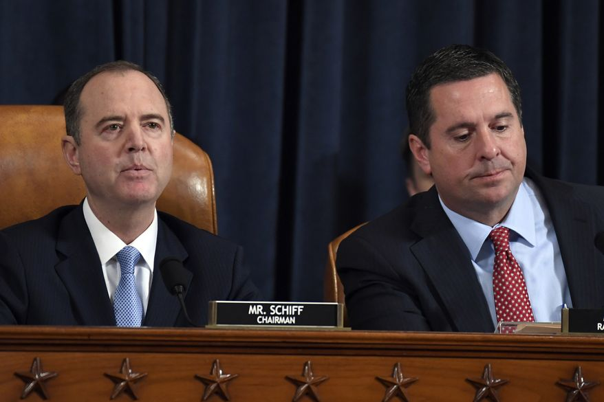 House Intelligence Committee Chairman Adam Schiff of Calif., left, speaks as Rep. Devin Nunes, R-Calif., the ranking member on the committee, listens during the House Intelligence Committee on Capitol Hill in Washington, Wednesday, Nov. 13, 2019, in the first public impeachment hearing of President Donald Trump's efforts to tie U.S. aid for Ukraine to investigations of his political opponents. (AP Photo/Susan Walsh)