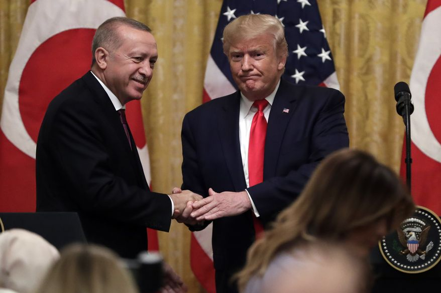 President Donald Trump shakes hands with Turkish President Recep Tayyip Erdogan after a news conference in the East Room of the White House, Wednesday, Nov. 13, 2019, in Washington. (AP Photo/ Evan Vucci)