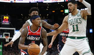 Washington Wizards' Bradley Beal looks for a way around the double-team of Boston Celtics' Enes Kanter (11) and Marcus Smart during the fourth quarter of an NBA basketball game Wednesday, Nov. 13, 2019, in Boston. (AP Photo/Winslow Townson)
