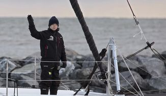 Swedish teen climate activist Greta Thunberg waves from the  48-foot (15-meter) catamaran La Vagabonde as it departs Salt Ponds in Hampton, Va., on Wednesday, Nov. 13, 2019.  Thunberg left North America on a return trip across the Atlantic hitching a renewable-energy ride with an Australian family aboard their catamaran.  (Rob Ostermaier/The Virginian-Pilot via AP)