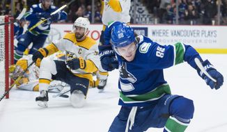 Vancouver Canucks center Adam Gaudette (88) celebrates his goal past Nashville Predators goaltender Pekka Rinne during the third period of an NHL hockey game Tuesday, Nov. 12, 2019, in Vancouver, British Columbia. (Jonathan Hayward/The Canadian Press via AP)