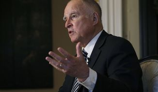 FILE - In this Tuesday, Dec. 18, 2018 file photo, then California Gov. Jerry Brown talks during an interview in Sacramento, Calif. California's first-in-the-nation law requiring publicly held companies to put women on their boards of directors faces its second legal challenge. Pacific Legal Foundation sued in federal court on Wednesday, Nov. 13, 2019, arguing that the law violates the U.S. Constitution's equal protection clause.   (AP Photo/Rich Pedroncelli, File)